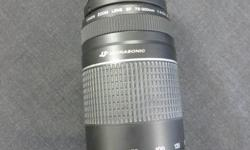 MoneyMaxx has a Canon Zoom lens -EF 75-300mm f/4.0-5.6 III The optical system, construction, and exterior are the same as the EF 75-300 mm f/4-5.6 III USM's. The difference is that it uses a DC motor instead of a USM to drive the AF. Come on down to