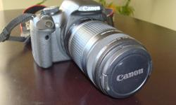 A complete Digital 15.1 Megapixel SLR camera package in premium condition. Takes awesome quality photos and HD video. This package includes: Canon Rebel T1i EOS 500D Camera body; Canon EFS 18-55mm Lens Canon Filter (UV Protector) 2- Canon LP-E5 batteries