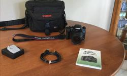 Canon Rebel EOS T1i Digital DSLR Camera DS126231; 18-55mm 58mm Zoom Lens; LC-E5 Battery Charger; 2 LP-E5 Batteries; Transfer cable; instruction manual & pocket version; and a new Canon camera case. Everything is in excellent condition. Well cared for.