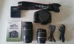 Canon Rebel T1i camera comes with a Canon 18-55mm Image stabilizer lens and a Canon Ultrasonic 75-300mm Zoom lens. Includes owners manual, battery, charger and original cords. Camera takes SD Memory cards (not included) This camera has been used very