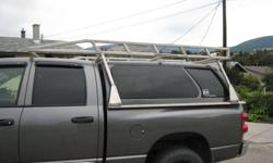 Insulated Canopy for short box dodge Sliding drop down front canopy window, 2 side opening windows. 4 Tires and rims aprox 60% wear left
