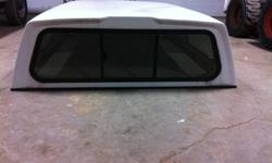 white truck canopy that came off a long box 89 chevy.  Tinted windows, front and side sliding windows. In great shape.
