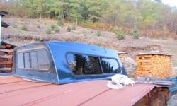 Canopy fits Toyota Tacoma up to 2004. (76'' long x 60'' wide) Good shape. $200 OBO