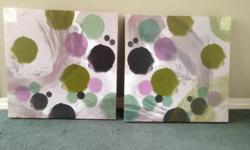 PAIR OF SQUARE 18 inch decorative prints with beautiful hues of purple, lavender, grey and green with wall brackets. As new.