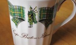 Fine Bone China Made in England. 4 Tea Mugs, 2 are child's size