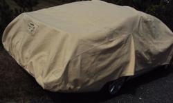 CAR COVER, IT IS CLEAN AND LOOKS BETTER THAN THE PICTURES 250 748 4953.
