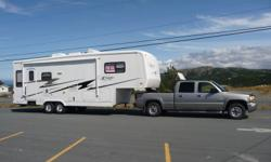 """Carriage 2004 Model 30RLS 5th Wheel  Living/Kitchen Slide, Bedroom Slide, Two Swival Rocker Recliners, Remote Control Furnace and Air Conditioning, Power Air Vents, 10 Gal Water Heater, Double Floor System with Basement Storage in front and back 8 Lug 16"""""""