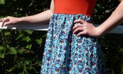 summer dress size Womens Extra Small - Small also fits Girls age 14-16 orange top part with attached blue & orange pattern skirt zip at back elastic waist by Xhilaration top part is 65% polyester 35% rayon, skirt is 100% cotton New, never worn -only put