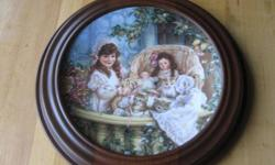 Limited edition third plate in the Hearts and Flowers from Sandra Kuck collection. Rimmed in 23-karat gold. 120 firing days. Set in a hardwood Woodridge frame, walnut stain. Certificate of Authenticity included. I have 3 plates from this collection.