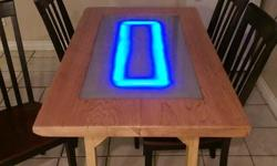 4-6 person dining table, made from cedar slab with glass and LED lighting. All very clean no dings or scratches. Adds some character and a beautiful smell to the home. Please email or call with any questions. Would be happy to answer them. Located in