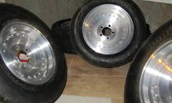 Centerline style Wheels 5 bolt unilug 2 14x7 with 245 60 14 2 15x8.5 with 265 50 15 Old school BF Goodrich (60-75%) 4 Center caps Very good condition One wheel has slight corrosion (see pic) Made in USA (Unknown Brand) Tag: mags wheels rims tires mustang