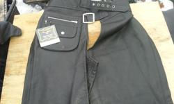 GARMENT QUALITY LEATHER, FULL ZIPPERS. ELASTIC ON BACK OF WAIST. POCKETS ON ONE SIDE ONE SNAP ONE ZIP, VELCRO AT BOTTOM OF LEGS. I HAVE ALL SIZES RIGHT NOW.ALSO HAVE TWO USED PAIR FOR $60 LARGE AND EXTRA LARGE,