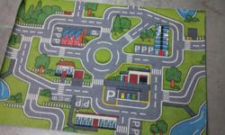 """Measures 52.5"""" x 36"""". Very clean, as it was 'gently' (rarely) used. The layout provides streets, roundabout, gas station & parking stalls etc...great for hot wheels! Please call. Seller will NOT respond to texts or emails."""