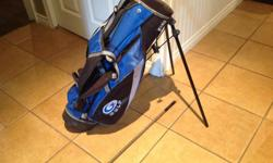 Child size golf bag, like new, with one club.
