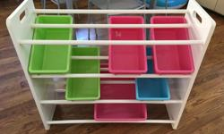 """In great condition, children's shelving unit with green pink and blue boxes. 5 small bins and one large bin. Measures 31"""" high, 34"""" wide and 12"""" deep."""