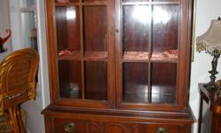 """Antique Mahogany - one piece Base 16"""" wide x 36"""" long China cabinet is 13 1/4"""" wide Height 71 1/2"""" Right top hand corner is chipped."""