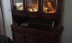 Solid Oak (I think) china cabinet. Hutch. 2 pieces. Great condition. Was my grandparents. I believe its 40 years oldish. Has a light as you can see in one of the pictures. 78 inches tall 58 inches wide 17 inches deep