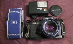 The made-in-Japan Chinon camera and lens (Pentax 1:2 /50mm) are in excellent working and cosmetic condition. The package also includes a flash unit, a wide Chinon strap and Pentax lens cap. A capable and inexpensive package for getting into film