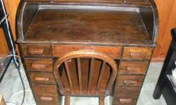 circa 1900 oak childs rolltop desk. have receipt of purchase for $650 in 1992. Very pretty must sell price $550