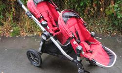 This City Select Stroller comes with two Ruby seats, plus a bucket seat attachment and a detachable cup holder. I believe it is the 2010 model. The car seat adapter says it fits Graco/Envenflo/Britax on one side, and if you flip it over it works for