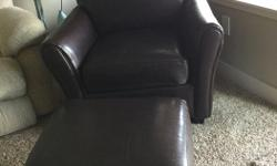 Dark brown pleather club chair and ottoman