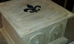 """Solid wood coffee table in an antiqued white wash finish. Inside opens for storage. Dimensions are - 30""""D x 30""""w x 19""""H $125.00"""