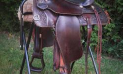 """Looking for a comfy trail saddle? Check out this 16"""" Canadiana Western Rawhide Trail Saddle. This beautiful saddle is designed with Ralide Tree with Quarter Horse Bars. It has a gullet width of 6-1/2"""" and 7"""" high. The skirt measures 26"""" in length. Comes"""