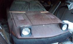 Make Triumph Model TR7 Year 1976 Colour Brown kms 12000 Trans Manual 1976 Triump TR7 , Hard Top with Sun Roof , 4 Cylinder , 4 Speed Standard with spare engine. Garage kept for last 22 years , last ran 8 years ago. Complete car , not missing any parts.