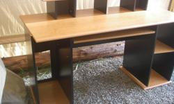 """Basic Computer desk. 5ft. long, 2ft. wide, 30"""" high. The desk in the picture is not put together , it is just resting in place. Good basic student desk."""