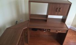 """3 pc. walnut looking veneer computer desk complete with side shelves. 59""""Wx24""""Dx50.5""""H. $75.00 250-743-8154 .Please no calls after 8 p.m."""