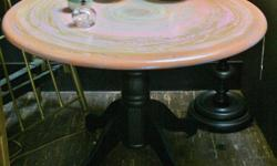 """Bring an ocean element into your decor with this conch shell inspired pedestal table at The Junction! One of a kind, custom painted with a beautiful and durable finish. Easily seats four, or 5 if needed. 42""""diameter x 30""""high. Come on down to """"The"""