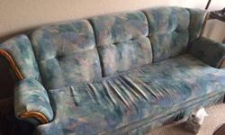 Full size couch for sale .... worn but comfortable. Good for rec room.