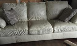 2 Cream coloured leather couches. They're in good condition.