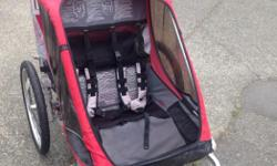 Double Chariot, Cougar 2 model with jogging and bike trailer attachment. Well used over the last 6 years, but the kids are now too big. One rip in the material as per picture, but the rest is in good shape. Rain and screen cover included. Carrying bag