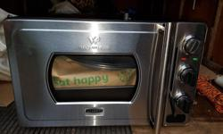 wolfgang puck pressure oven with rotisserie. this countertop oven does everthing you would want. used one time, it was a Christmas gift for my 95 year old mom, she could not figure it out.price 650 dollars. 1st 200 takes it. all information telling you
