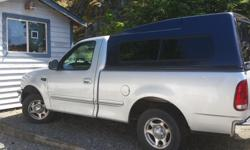 Make Ford Model E-150 Colour Silver Trans Manual kms 163000 My truck has disk brakes 5 speed manual trans, air conditioning Bumper hitch and light hook-up 60% tires full bed liner with $1200 canopy stereo with disk player power windows and mirrors , air