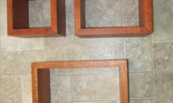 """Set of 3 decorative cube shelves 9""""x9"""", 7""""x7"""", and 5""""x5""""."""