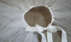 Perfect Gift for the Little Girl who dreams of being a ballerina! Custom hand-made tutus with your choice of colour ribbon and skirt! Gems and embellishments can be added for a small additional fee! Order ASAP for the Holiday Season! Smallest size for