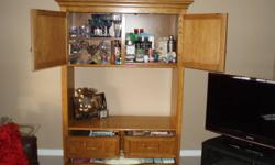 Custom made solid oak hutch in good condition. Must sell. This item is heavy and will need to be moved by purchaser (only needs to be brought up one level/flight of 7 stairs). Have used in the bedroom for TV and clothing, as well as in the family room for
