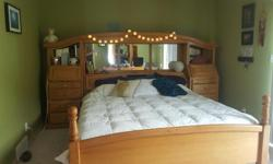 5 years old, in mint condition, headboard with mirrors and lots of cupboard space, attached side cupboards, reading lights, memory foam mattress. Has to be sold by Sa Aug 27th. Paid $5000 but willing to sacrifice for $1500 OBO since it does not fit in my