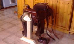 Hand crafted by the master himself in Alberta Barrel or trail , wide tree , 15 inch bicycle seat seat , matching breast collar all in like new condition can phone for info