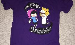 """""""Dan is not on fire"""" t-shirt. First edition t-shirts from the Dan and Phil Shop in UK. One unopened/still in packaging for $20 and one used for $10. Size Medium."""