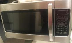 Danby Designer Stainless Steel Microwave for sale. 20 inches in length x 12 inches in height x 15 inches in depth. Model DMW111KSSDD. For countertop use. Five years old (Manufactured 11/2013). Selling as installed a built in microwave oven.