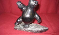 Dancing Bear Artist: Leo Patrick Material: Black Soapstone Size: 7? width x 7? height Price: $600.00