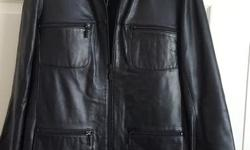 Might as well be brand new! Danier very soft leather black car coat with removable liner. Size says extra small, but fits like a small to medium. Also have a Danier dark brown leather jacket ($40) and Danier red leather jacket, with removable liner ($50).