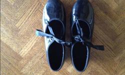 For sale is a pair of Danskin brand tap shoes (size 3). Good condition.