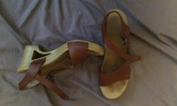 Great brown leather Dansko sandles. Super comfortable for heals but I've developed bunions (yay for me!) and I can't wear them anymore. Maybe you can? $125 new.