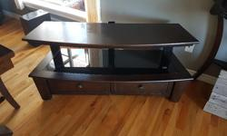 Dark Wood and Glass TV Stand bought from Costco about 3 years ago, paid $269.00. Good condition. L - 49 5/8 W - 20 1/8 H - 23 1/4