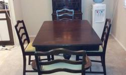 I just bought this set through Craigslist sight unseen and realize it doesn't work in our dining room. The set is 50 years old but is in good condition for its age. It comes with table, leaf, 6 chairs and hutch. The table and hutch have a few nicks and