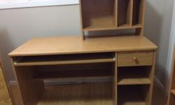"""Oak laminate desk with removable hutch 23"""" D x 50"""" W x 29"""" H Hutch is 19 1/2"""" H x 9 1/2"""" D x 25"""" W We're downsizing, so we won't need two desks anymore or these other items: 3 shelf oak color bookcase, 3 pc solid oak coffee table set, oak mirror"""